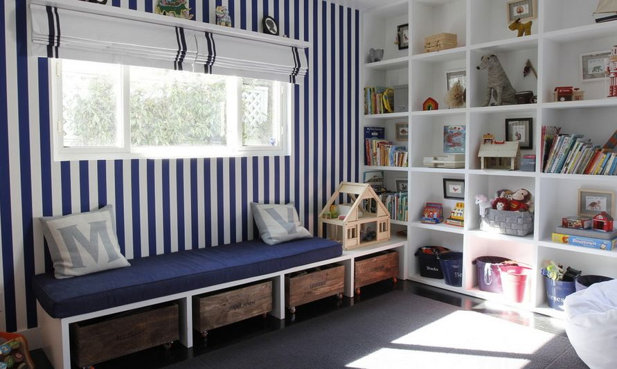 Striped walls and different storage system for playroom